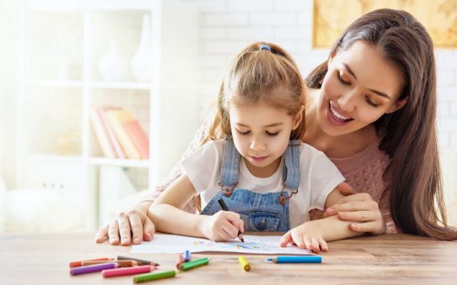 Children Drawing with European Nanny