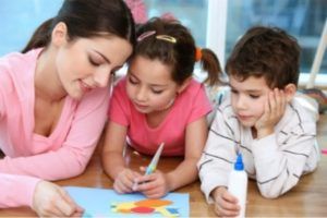 Children Drawing with European Nanny'